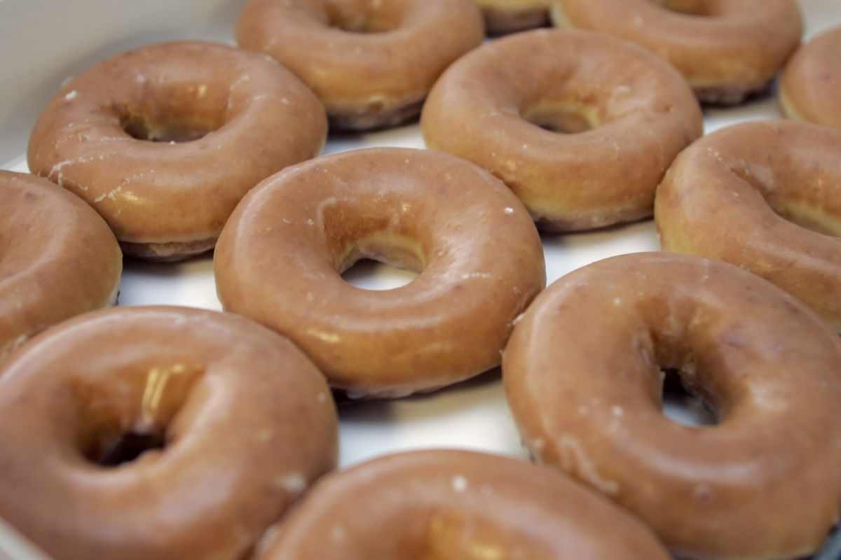 You can get a free dozen Krispy Kreme glazed doughnuts now until Jan 27 with the purchase of any dozen.