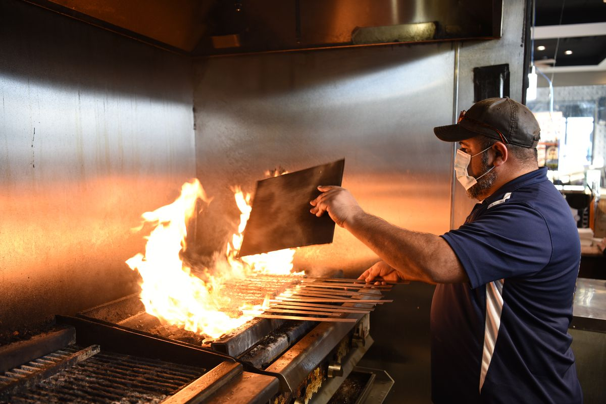 Owner Hasan Alzergani manages the fiery grill at Arbeel Kabab,