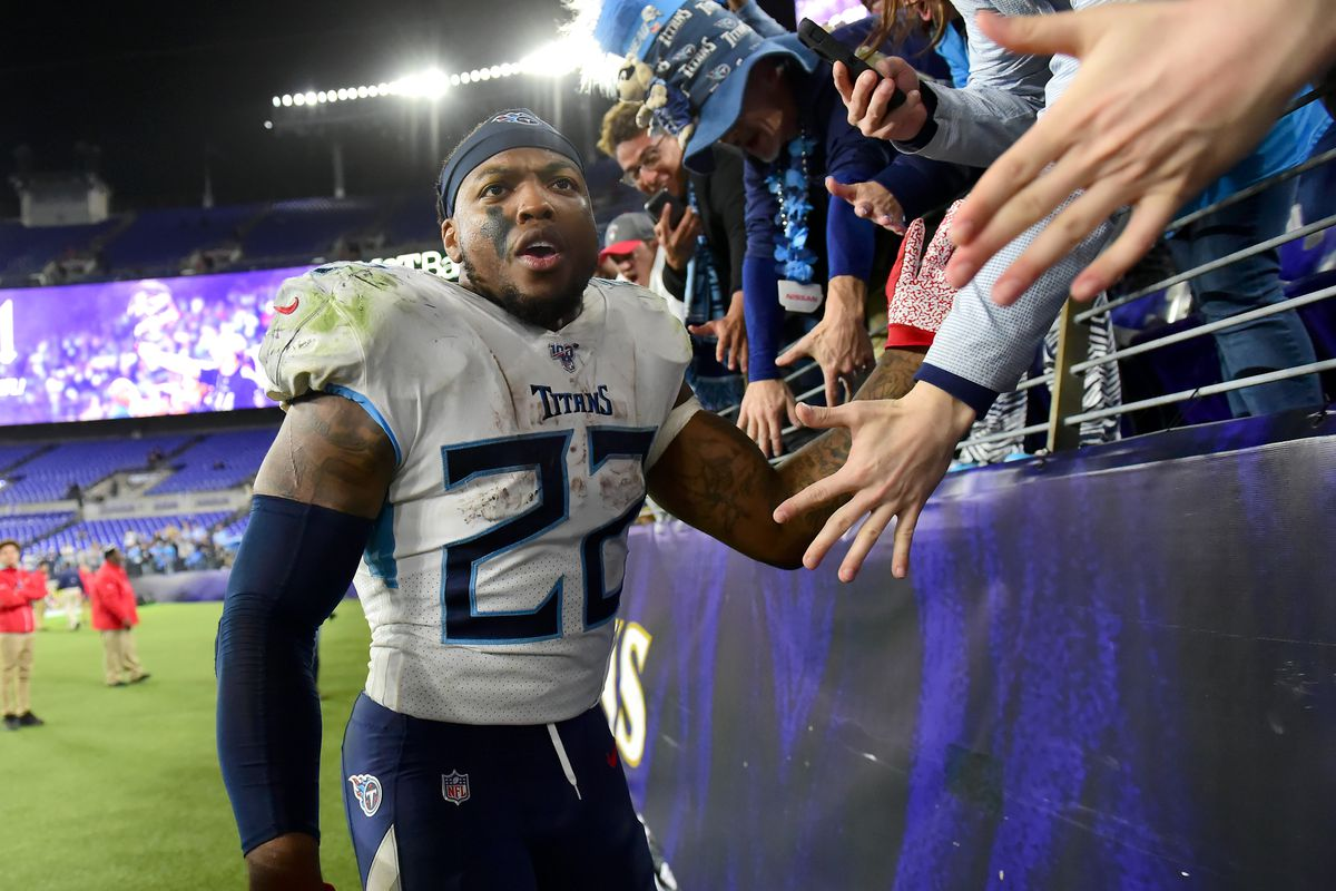 Tennessee Titans running back Derrick Henry celebrates with fans after beating the Baltimore Ravens 28-12 in a AFC Divisional Round playoff football game at M&T Bank Stadium.
