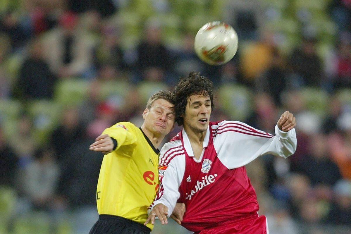 Christian Worns of Dortmund in action against Roque Santa Cruz