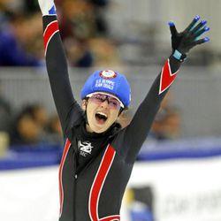 Katherine Reutter-Adamek (5) reacts after winning the women's 1000-meters A final race during the U.S. Olympic short track speedskating trials Sunday, Dec. 17, 2017, in Kearns, Utah. (AP Photo/Rick Bowmer)