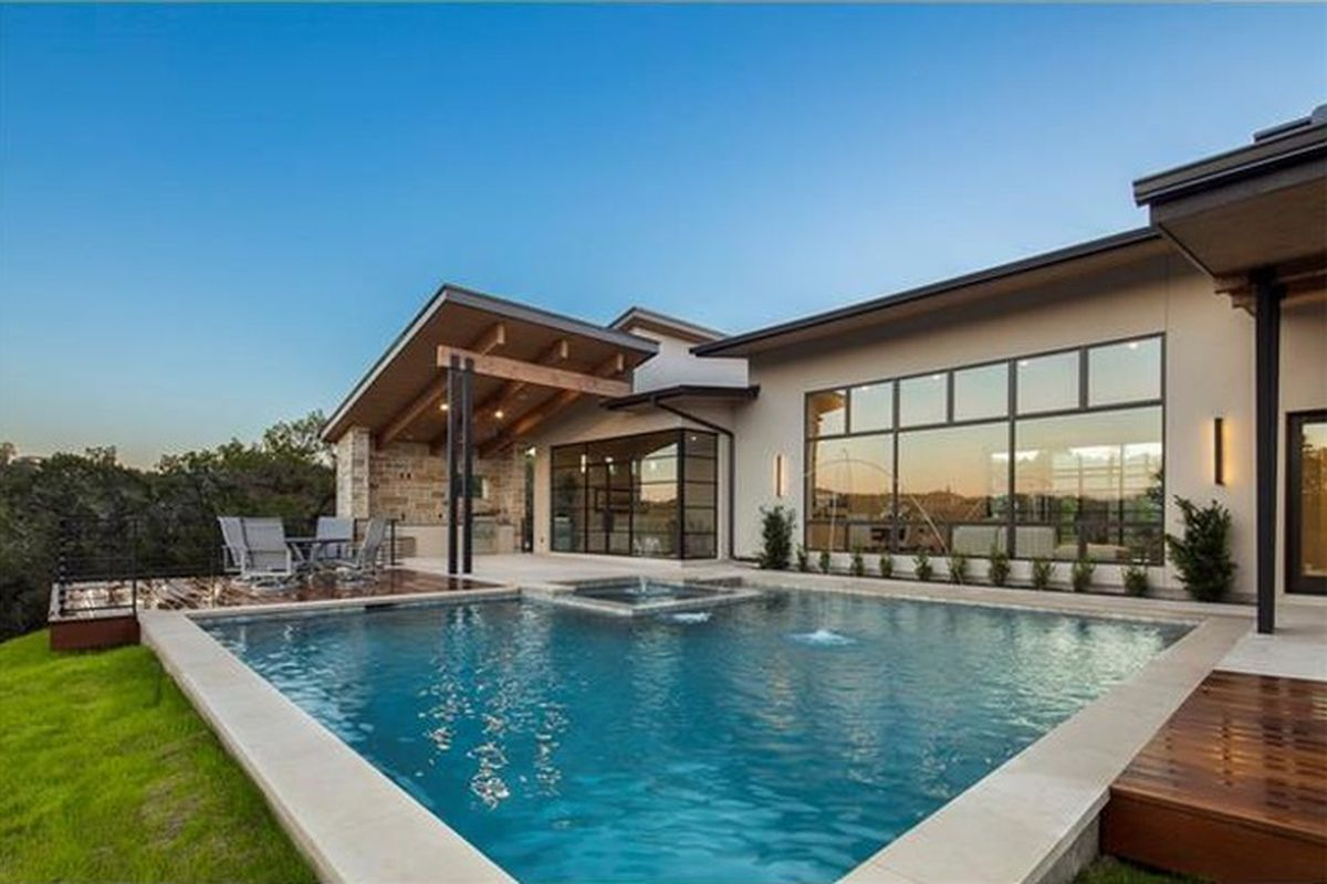 New contemporary home backyard with pool in foreground
