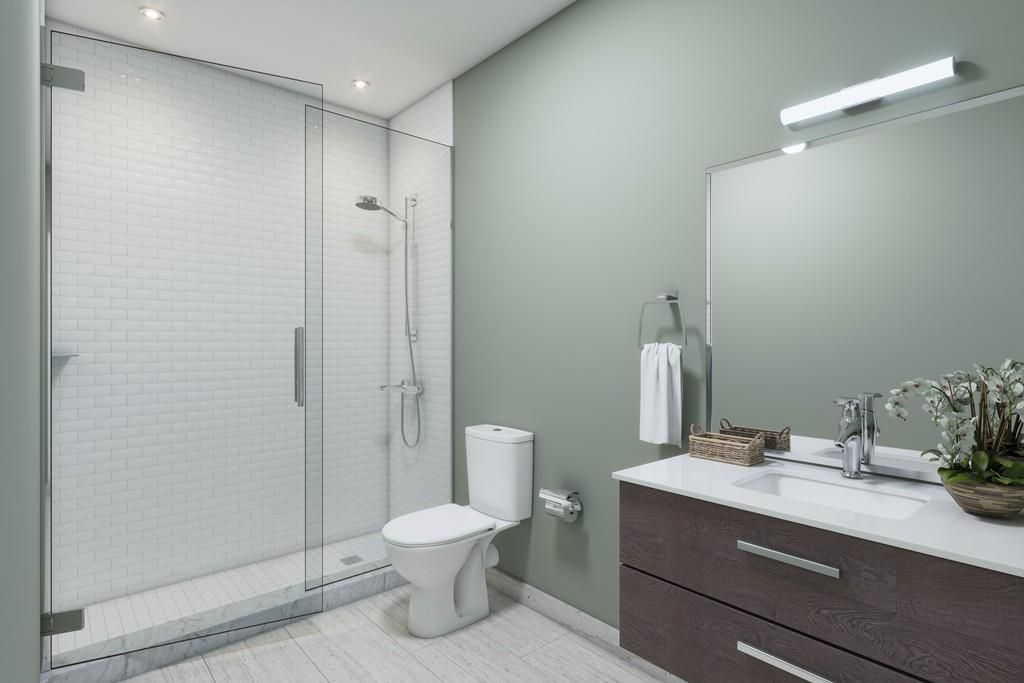 Rendering of a bathroom with a glass-doored shower.