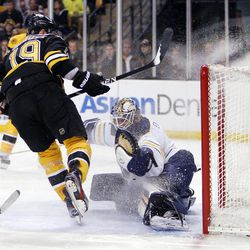 Boston Bruins' Tyler Seguin (19) scores on Buffalo Sabres' Jhonas Enroth in the second period of an NHL hockey game in Boston, April 7, 2012.