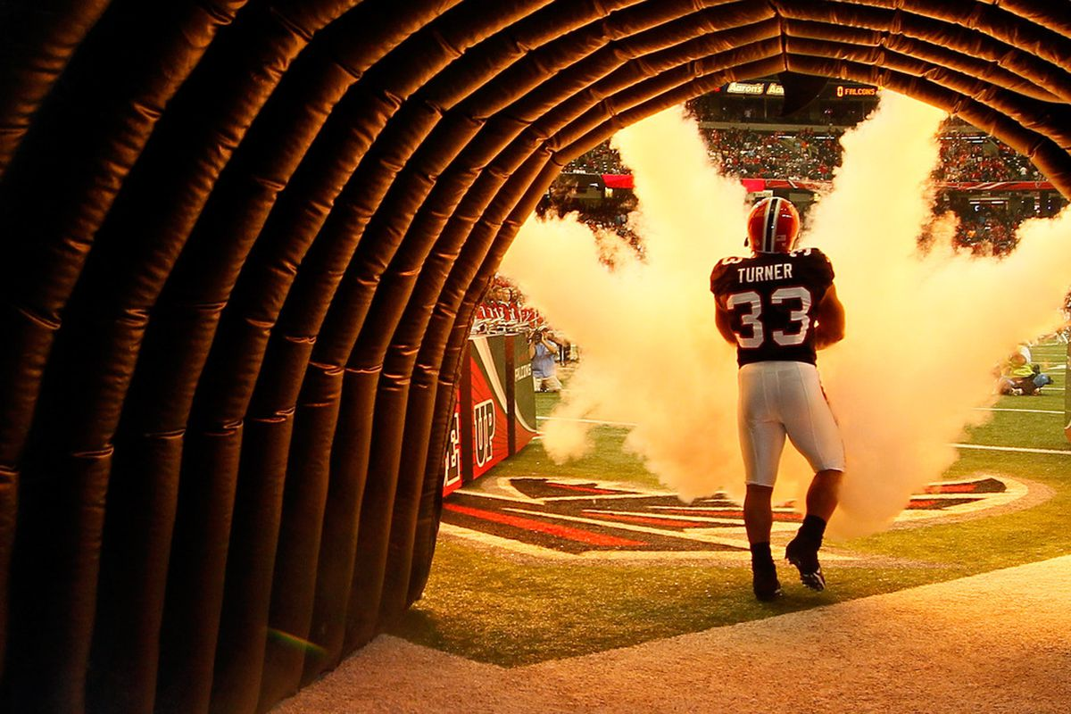 ATLANTA, GA - OCTOBER 16:  Michael Turner #33 of the Atlanta Falcons prepares to enter the field to face the Carolina Panthers at Georgia Dome on October 16, 2011 in Atlanta, Georgia.  (Photo by Kevin C. Cox/Getty Images)