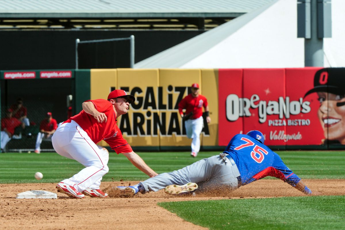 """Addison Russell steals second on Thursday. (Note the advertising sign that says """"Legalize Marinara"""" behind him)"""
