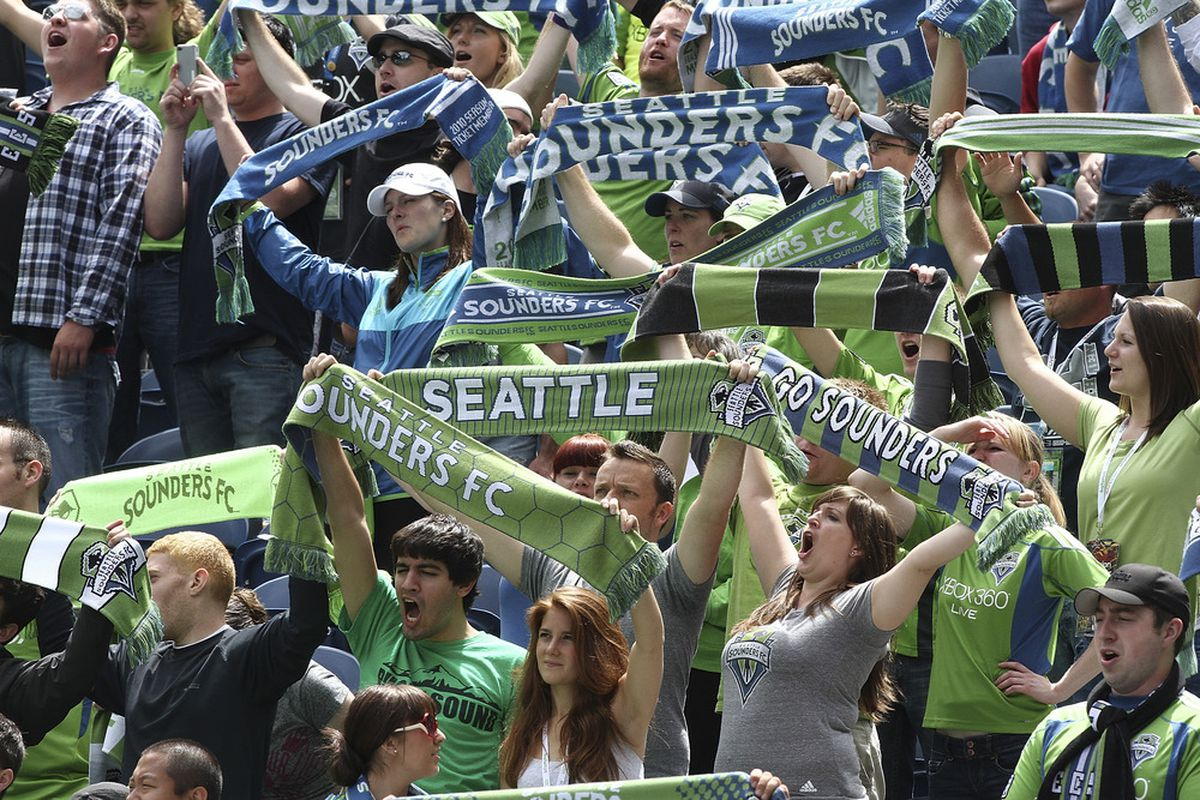 SEATTLE - JULY 16:  Fans of the Seattle Sounders FC cheer against the Colorado Rapids at CenturyLink Field on July 16, 2011 in Seattle, Washington. The Sounders defeated the Rapids 4-3. (Photo by Otto Greule Jr/Getty Images)