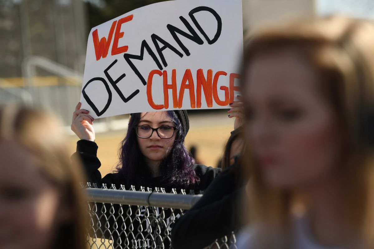 A student at Columbine High School holds a sign during a protest of gun violence, on March 14, 2018 in Littleton, Colorado.