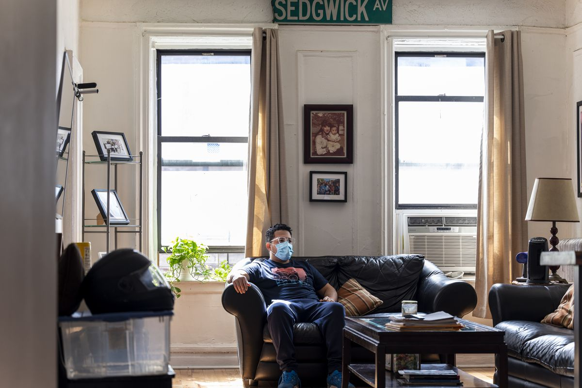Jason Torres in his living room in The Bronx.