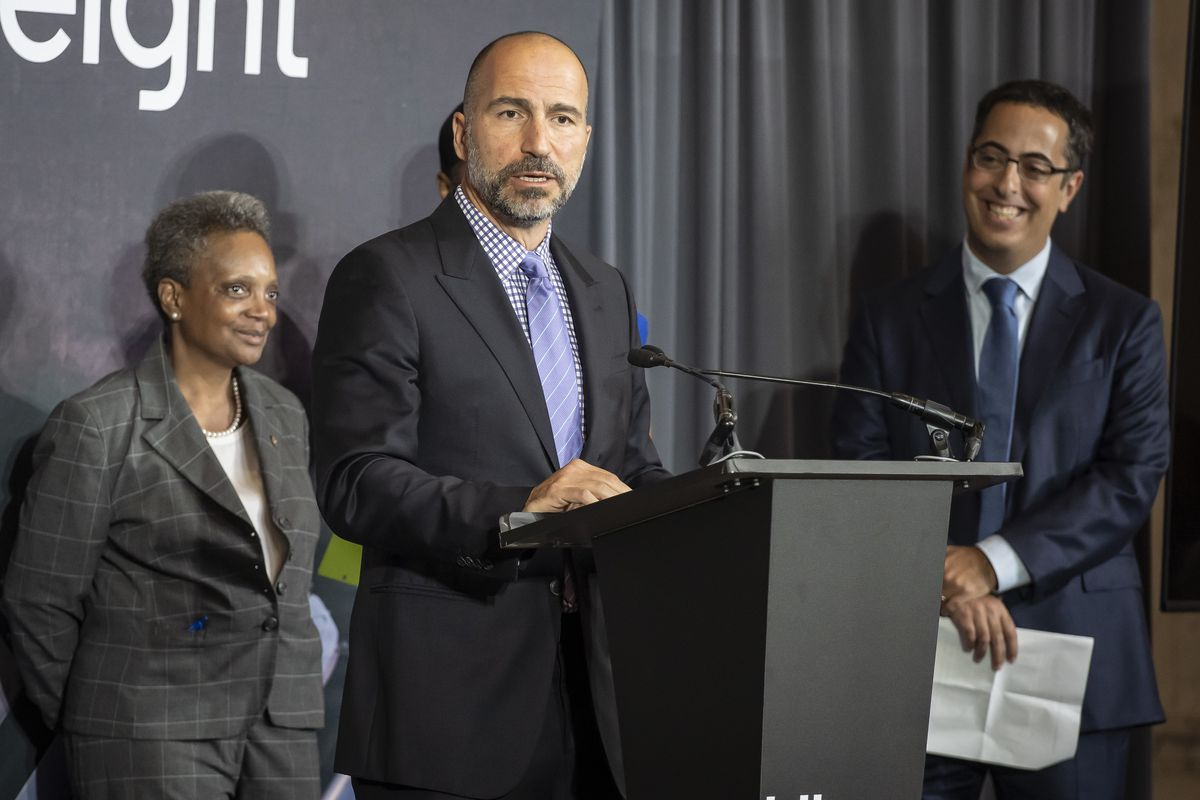 Uber CEO Dara Khosrowshahi (center) joins Mayor Lori Lightfoot (left) and Lior Ron (right) head of Uber Freight, at Monday's news conference at the Old Main Post Office.