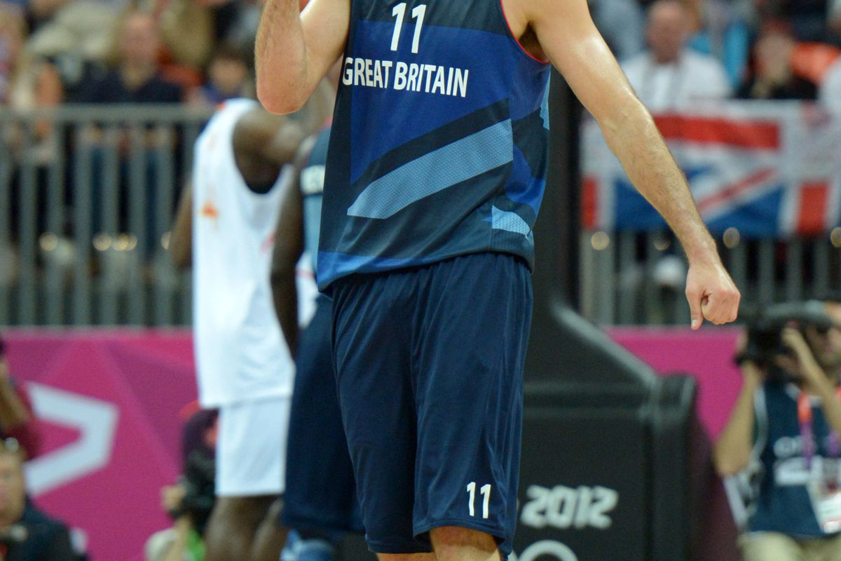 Aug 2, 2012; London, United Kingdom; Great Britain forward Joel Freeland (11) reacts during the preliminary game against Spain in the London 2012 Olympic Games at Basketball Arena. Mandatory Credit: Kirby Lee-USA TODAY Sports