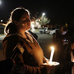 Cheyenne Miller along with Powell family friends and well wishers hold a candlelight vigil in Salt Lake County  Sunday, Feb. 5, 2012. Josh Powell and his two sons were killed in an explosion in Washington.