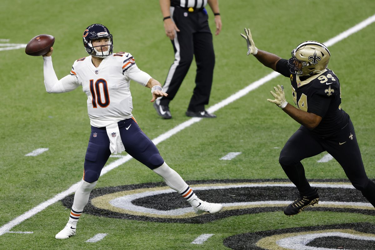 Chicago Bears quarterback Mitchell Trubisky (10) throws the ball in front of New Orleans Saints quarterback Drew Brees (9) during an NFL wild-card playoff football game, Sunday, Jan. 10, 2021, in New Orleans.