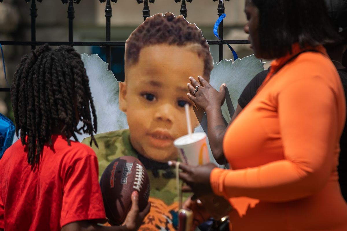 Mekhi James' touch a picture of him before a press conference on June 24, 2020. Mekhi James, who was three years old, was shot while his father was driving him home on Father's Day Weekend. | Pat Nabong/Sun-Times