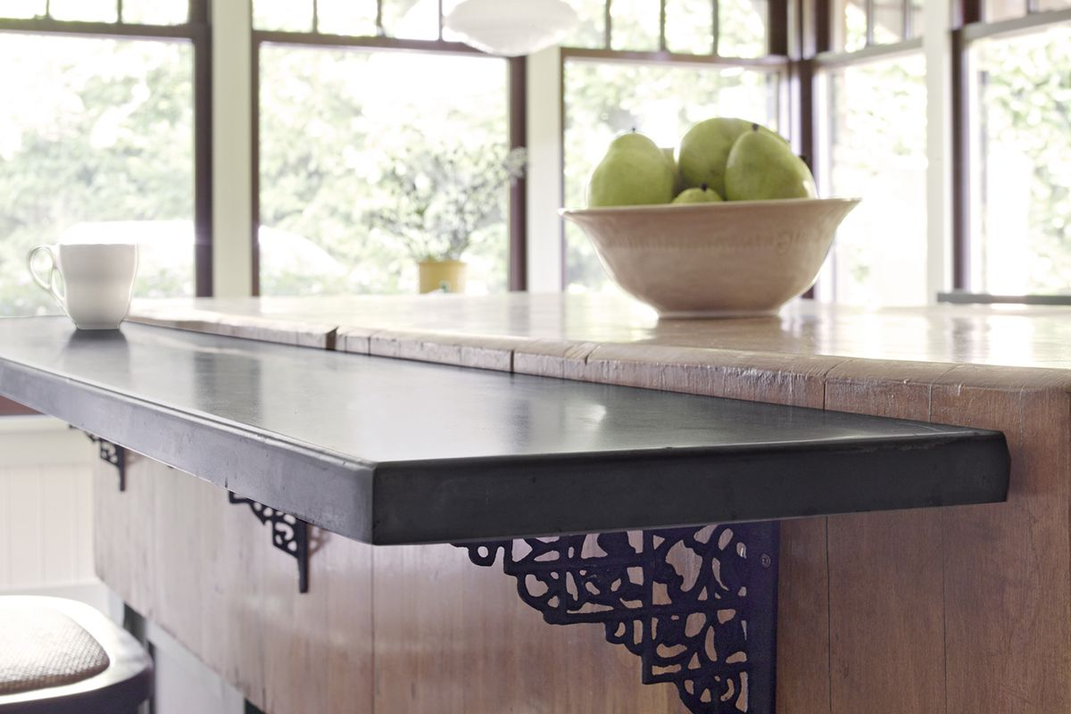 Mounted breakfast bar with brown countertop.
