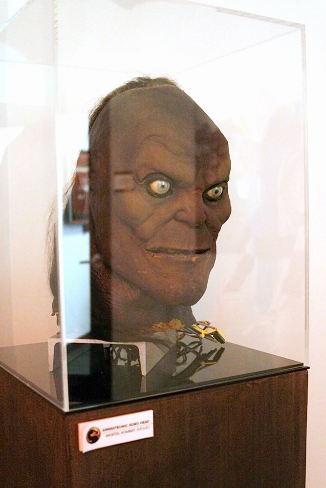 A photo of Goro's Head, taken during a tour of the studio in 2015. It sits in a dim corner due to its age.