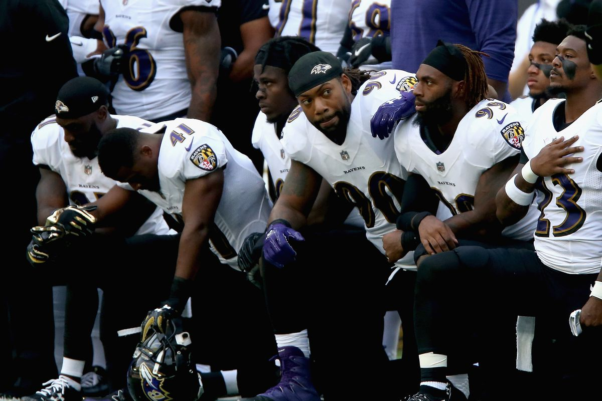 Baltimore Ravens players kneel for the American national anthem during the NFL International Series match between Baltimore Ravens and Jacksonville Jaguars at Wembley Stadium on September 24, 2017. in London, England.