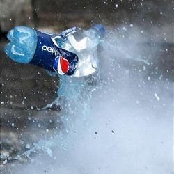 A Pepsi bottle explodes from the pressure of the chemical reaction in a homemade bomb.