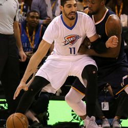 Utah Jazz forward Derrick Favors (15) guards Oklahoma City Thunder center Enes Kanter (11) during a basketball game at the Vivint Smart Home Arena in Salt Lake City on Monday, Jan. 23, 2017. The Jazz lost 95-97.