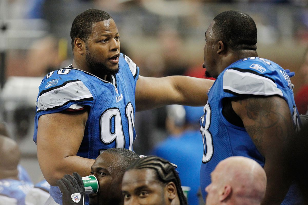 DETROIT, MI - NOVEMBER 20:  Ndamukong Suh #90 of the Detroit Lions talks with Nick Fairley #98 on the bench while playing the Carolina Panthers at Ford Field on November 20, 2011 in Detroit, Michigan.  (Photo by Gregory Shamus/Getty Images)