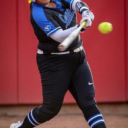 BYU infielder Olivia Sanchez (24) swings away as the University of Utah hosts Brigham Young University at Duke Stadium in Salt Lake City on Wednesday, April 18, 2018.