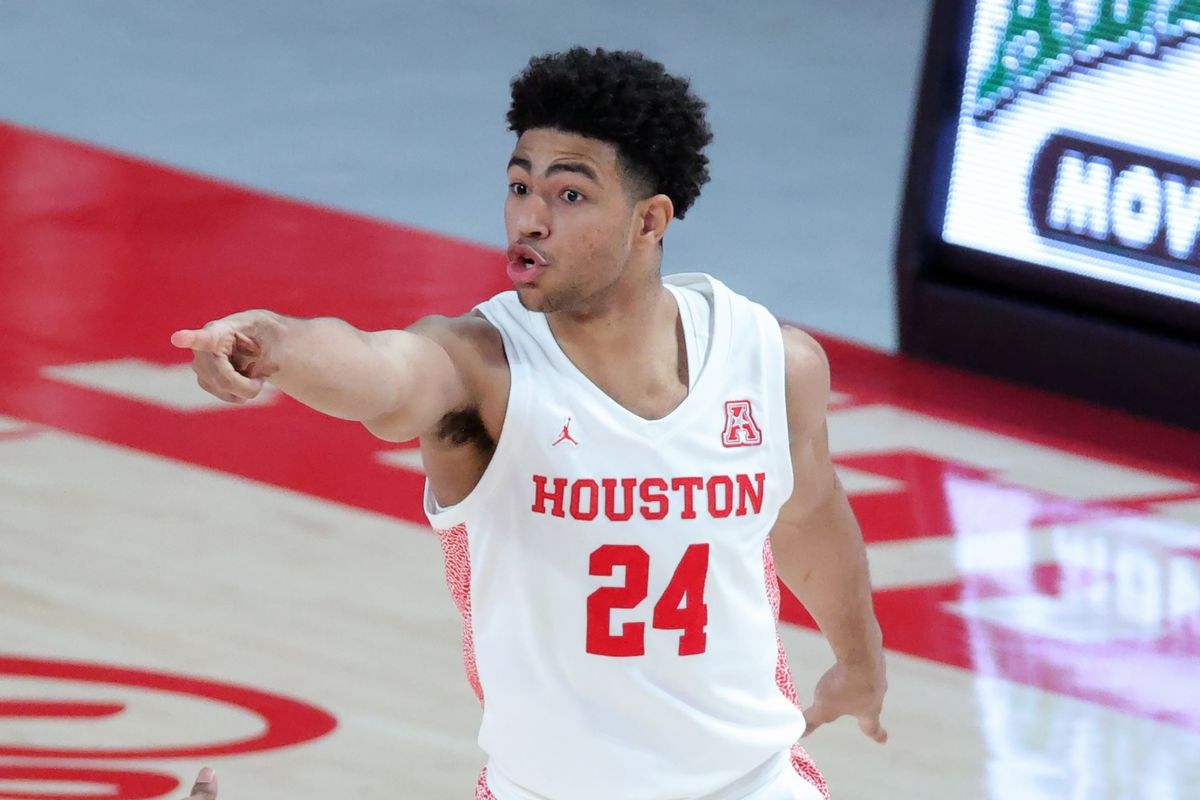 Quentin Grimes of the Houston Cougars reacts after a basket during the first half of a game against the Cincinnati Bearcats at the Fertitta Center on February 21, 2021 in Houston, Texas.