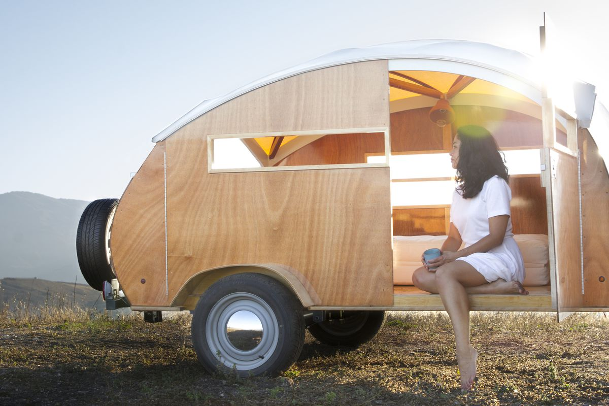 Wooden teardrop trailer is like a tiny land yacht for