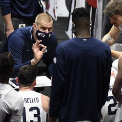 BYU head coach Mark Pope talks to his team in the first half of game against Southern California, Tuesday, Dec. 1, 2020, in Uncasville, Conn.