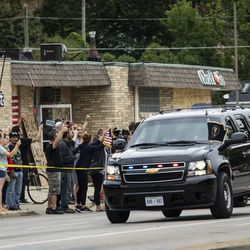 President Donald Trump's motorcade travels by Sheridan Road and 60th Street in Kenosha, Tuesday afternoon, Sept. 1, 2020.