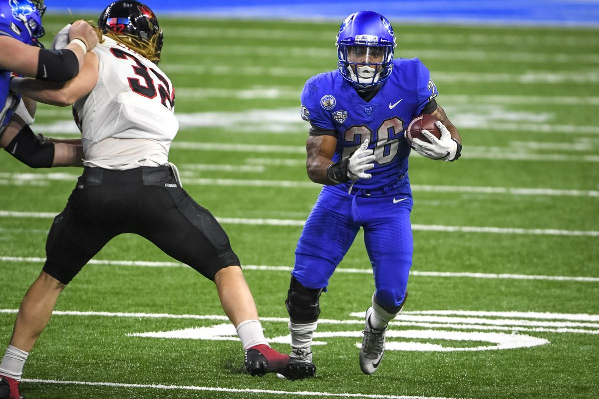 Jaret Patterson #26 of the Buffalo Bulls runs the ball against the Ball State Cardinals during the second half of the Rocket Mortgage MAC Football Championship at Ford Field on December 18, 2020 in Detroit, Michigan.