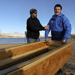 Brandon Watts, Utah Schools for the Deaf and the Blind director of outreach visions services, left, directs Isiah Smith as he helps move a section of a boat built by students on Lone Rock Beach at Lake Powell on Friday, March 26, 2021. Smith, who is 17, was born completely blind with bilateral retinal detachment. They are part of the school's yacht club, which is training for the SEVENTY48, a 70-mile human-powered boat race from Tacoma to Port Townsend, Wash.