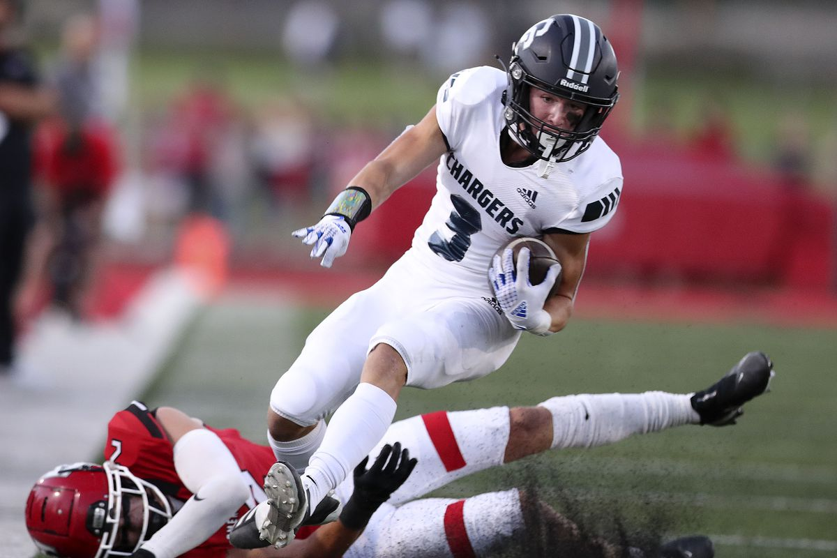 Corner Canyon's Cody Hagen drives past American Fork's Fisher Ingersoll at American Fork High School on Friday, Sept. 17, 2021.