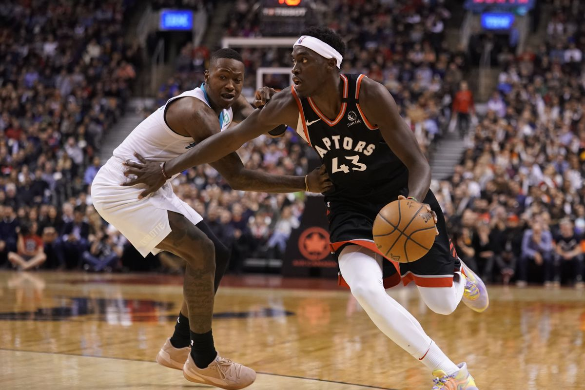 Toronto Raptors forward Pascal Siakam dribbles against Charlotte Hornets guard Terry Rozier at Scotiabank Arena. Charlotte defeated Toronto.
