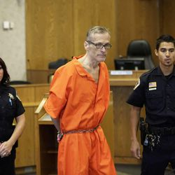 Martin MacNeill enters the courtroom before his sentencing Friday, Sept. 19, 2014, in Provo, Utah. MacNeill, who is serving a sentence of 15 years to life at the Utah State Prison for killing his wife, Michele MacNeill, in 2007, won't get his first parole hearing until he is 96 years old.