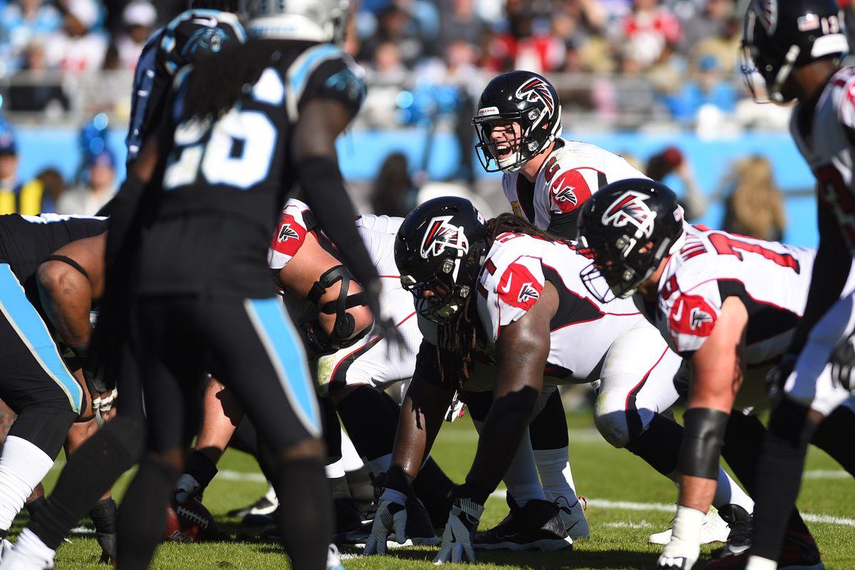 Atlanta Falcons quarterback Matt Ryan at the line in the second quarter at Bank of America Stadium.