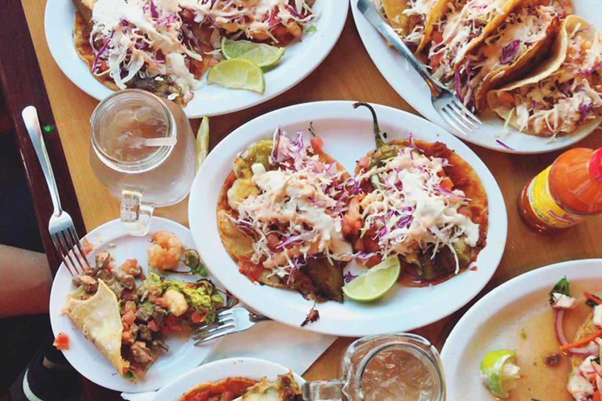 A collection of dishes including tacos, tostadas and chef specials served by the casual seafood restaurant.