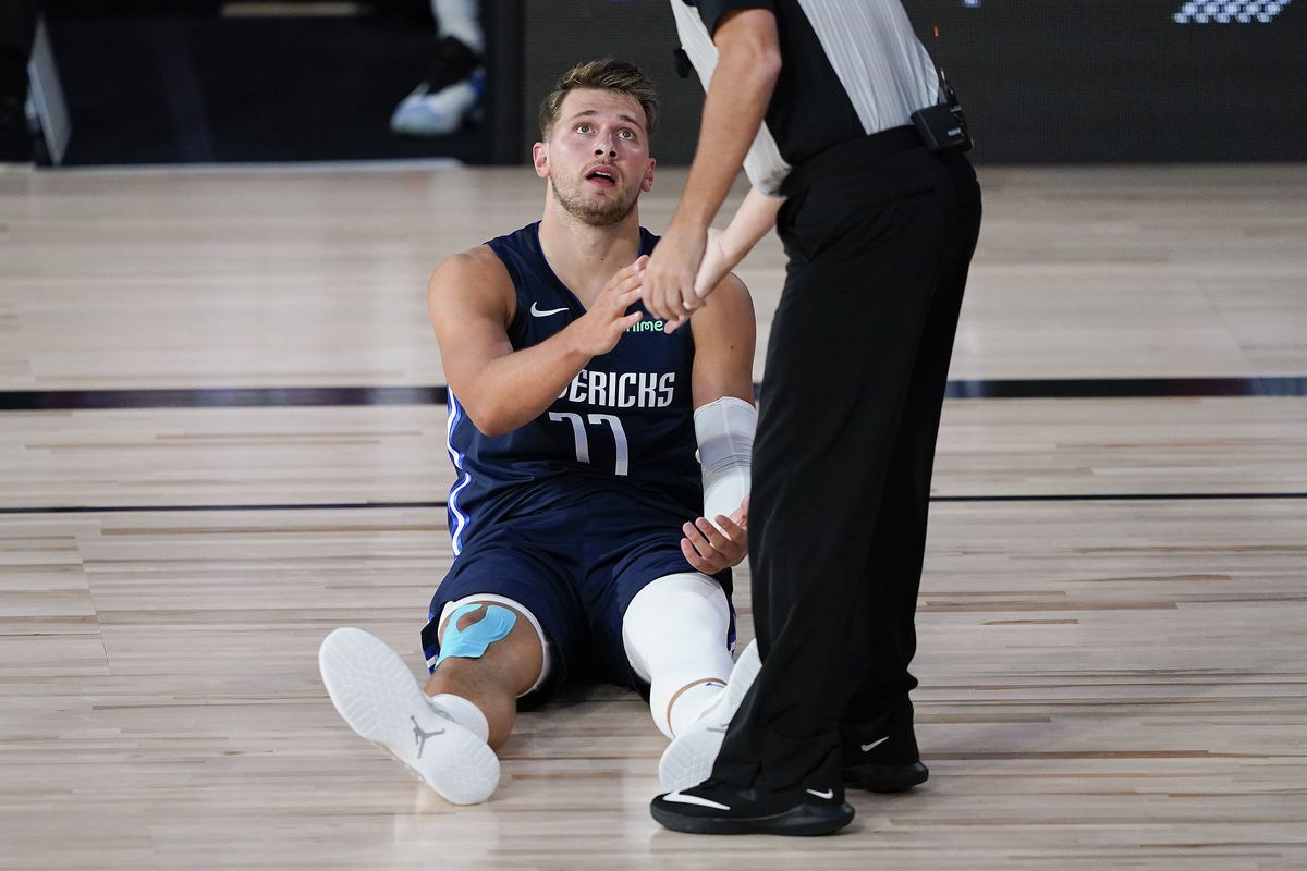 Luka Doncic of the Dallas Mavericks comments to the referee during action against the Phoenix Suns in the first half at Visa Athletic Center at ESPN Wide World Of Sports Complex on August 2, 2020 in Lake Buena Vista, Florida.