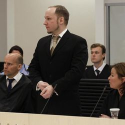 Norwegian Anders Behring Breivik, center, appears in court to face terrorism and premeditated murder charges, Oslo, Norway, Monday, April 16, 2012. Breivik, who confessed to killing 77 people in a bomb-and-shooting massacre went on trial in Norway's capital Monday, defiantly rejecting the authority of the court.