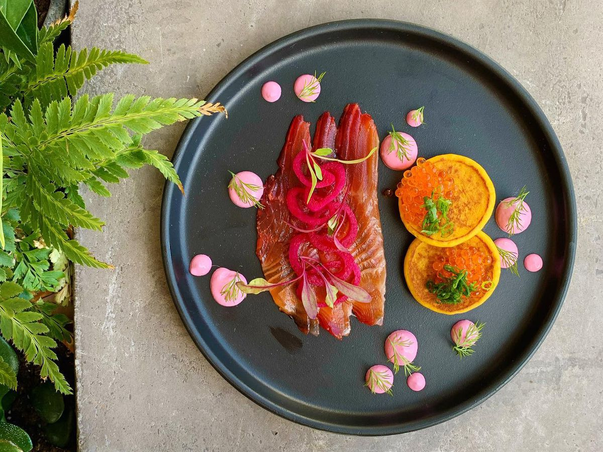 Gin and beet-cured steelhead lox, sweet potato blini, smoked trout roe, and beet creme fraiche at Heirloom in Lewes, Delaware
