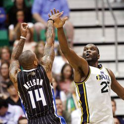 Utah Jazz center Al Jefferson (25) tries to disrupt the shot of Orlando's #14 Jameer Nelson as the Utah Jazz and the Orlando Magic play Saturday, April 21, 2012 in Energy Solutions arena.
