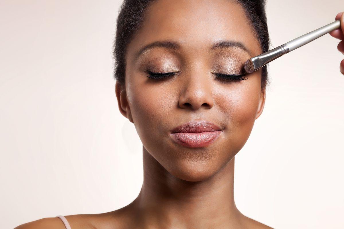 A woman getting eyeshadow applied
