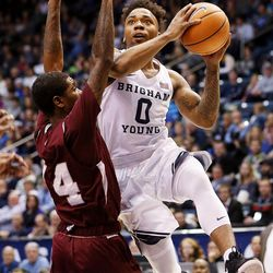 Brigham Young Cougars guard Jahshire Hardnett (0) goes up for a shot over Texas Southern Tigers forward Lamont Walker (14) as BYU and Texas Southern play an NCAA basketball game in Provo at the Marriott Center on Saturday, Dec. 23, 2017.