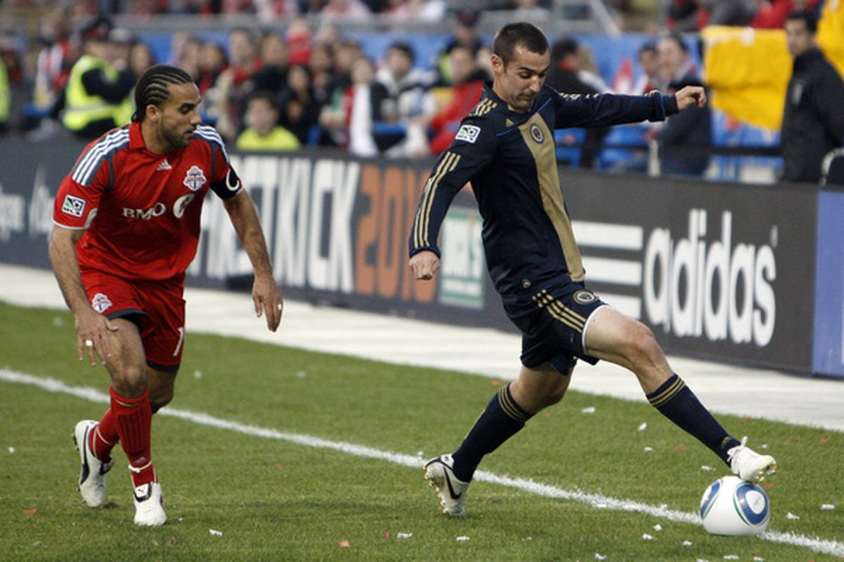 TORONTO - APRIL 15: Dwayne Derosario #14 of Toronto FC battles for the ball with Andrew Jacobson #8 with of Philadelphia Union during action at BMO Field April 15, 2010 in Toronto, Ontario, Canada. (Photo by Abelimages/Getty Images)