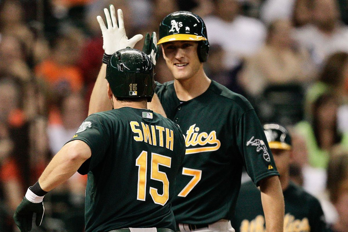 """Freiman puts the """"high"""" in """"high-5."""" Note that Smith is 6'3"""" and is standing closer to the camera."""