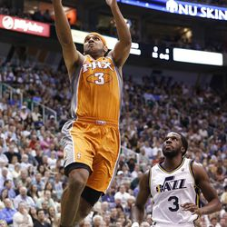 Phoenix Suns forward Jared Dudley (3) drives past Utah Jazz forward DeMarre Carroll (3) for a shot during the first half of an NBA basketball game, Tuesday, April 24, 2012, in Salt Lake City. (AP Photo/Jim Urquhart)