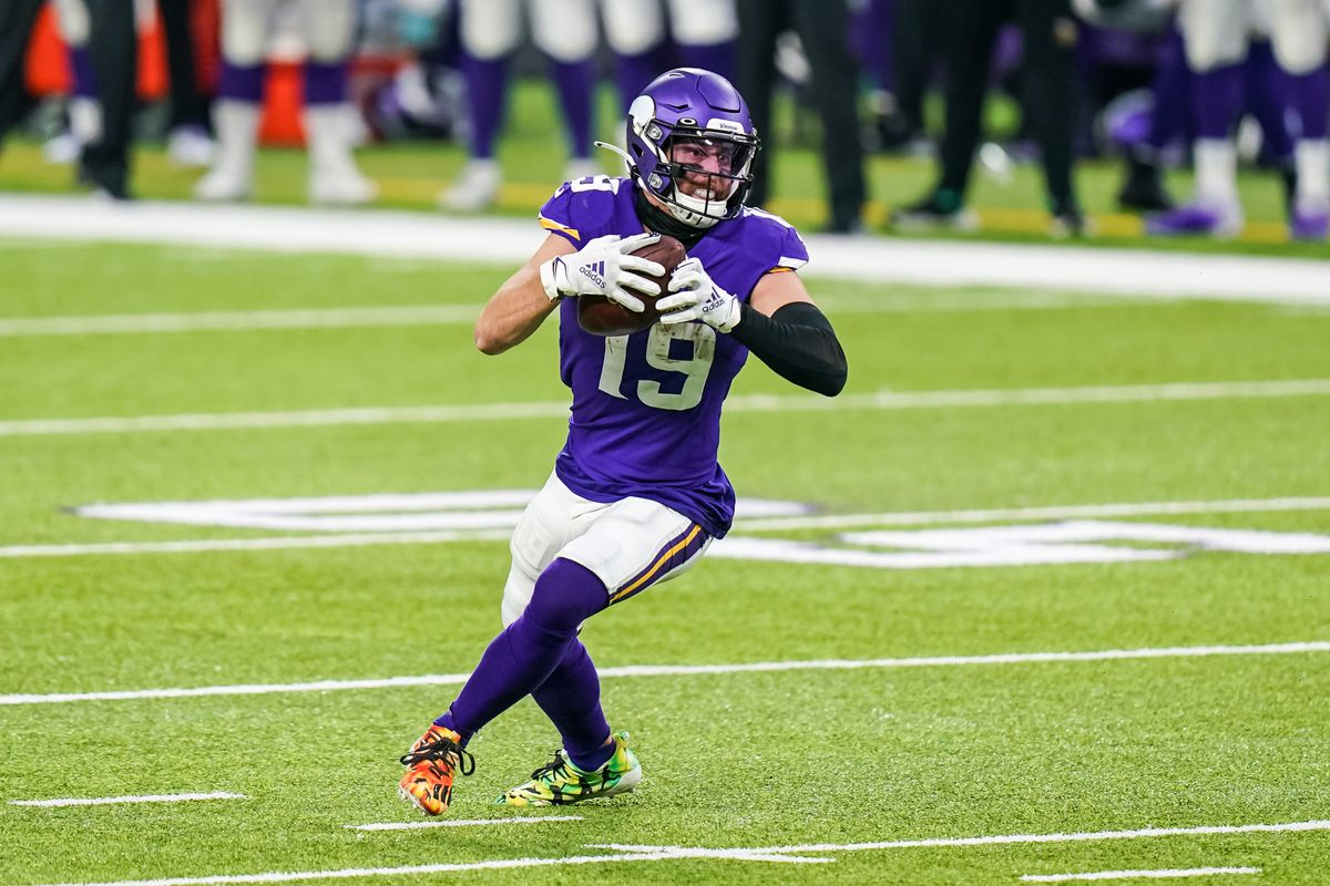 Minnesota Vikings wide receiver Adam Thielen carries the ball during the first quarter against the Jacksonville Jaguars at U.S. Bank Stadium.