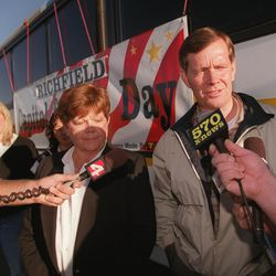 FILE - Olene Walker and Governor Mike Leavitt are interviewed before boarding a bus at the State Capitol.