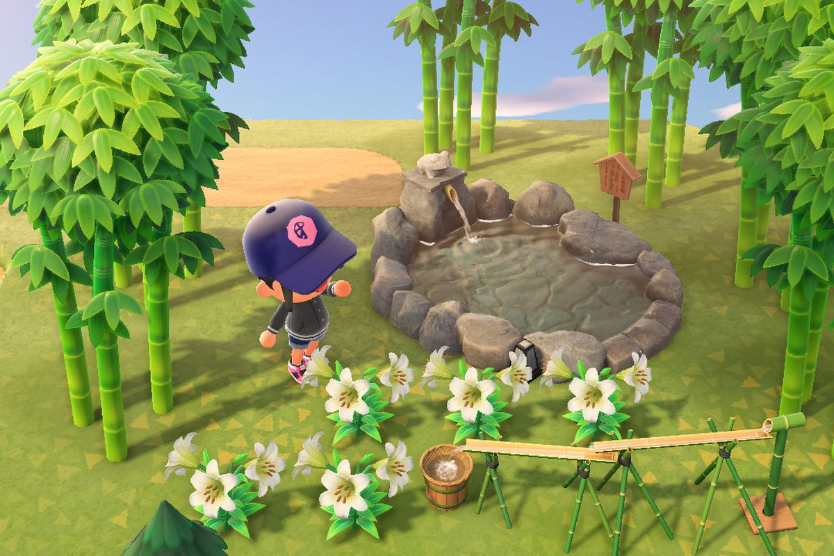 An Animal Crossing character stands around bamboo, a hot spring, and some lilies