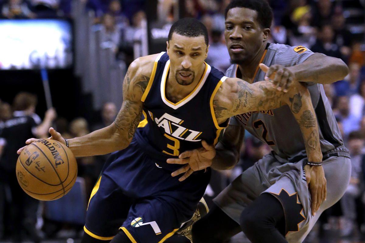 Utah Jazz guard George Hill (3) drives past Phoenix Suns guard Eric Bledsoe in the third quarter of an NBA basketball game, Monday, Jan. 16, 2017, in Phoenix. (AP Photo/Rick Scuteri)