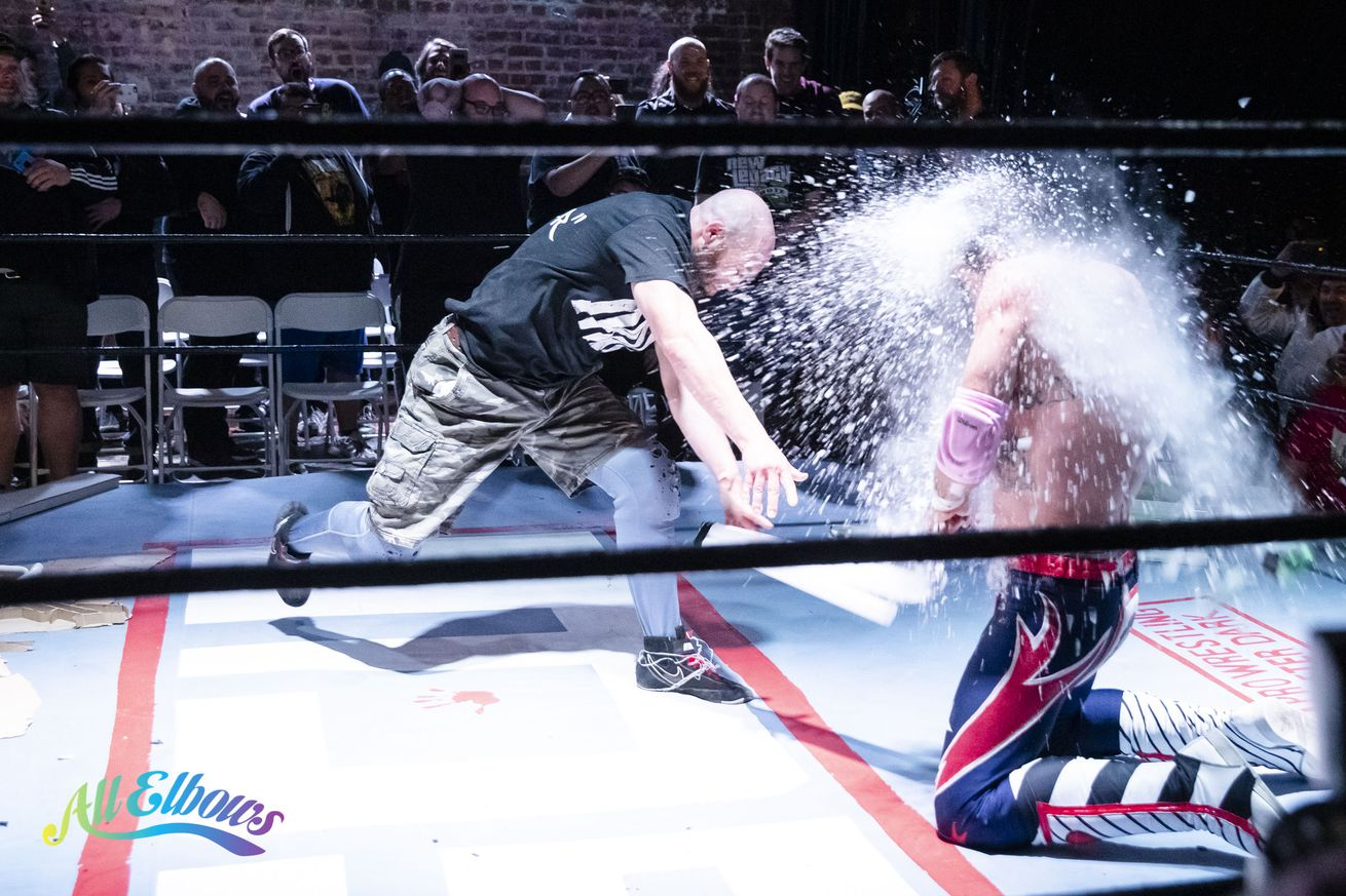 Nick Gage hits David Arquette with a light tube during their main event deathmatch at Joey Janela's LA Confidential on Friday night in Los Angeles.